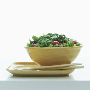 bowl of salad with tongs