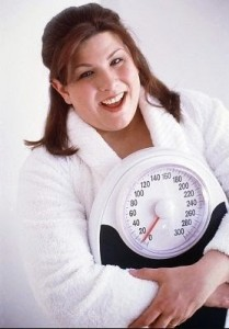 woman in robe hugging scale