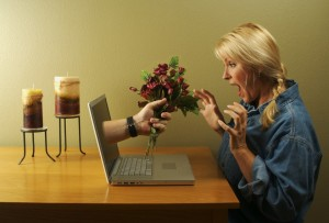 woman at laptop with flowers