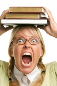 woman stressed books on head