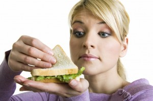 young blond Woman with healthy sandwich