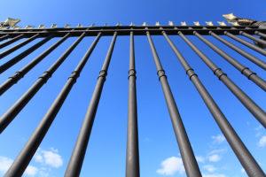 Iron fense symbolizing rigid boundaries