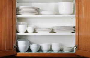 White Dishes and Bowls in Kitchen Cabinet