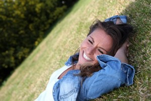 Beautiful woman laying down in the grass