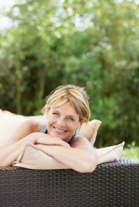 relaxed woman smiling on patio