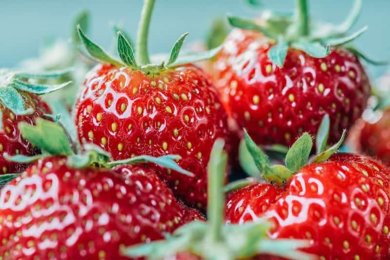 Basket of strawberries photographed up close.