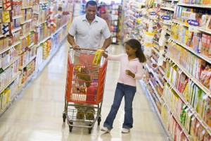 How scarcity beliefs trigger over-consumption when food is abundant