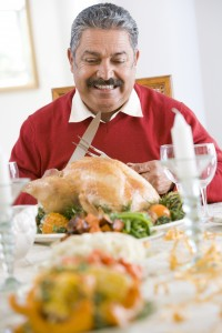 Senior Man Excitedly Getting Ready To Carve The Turkey