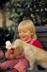girl sharing ice cream with dog