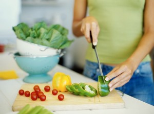 woman slicing veggies