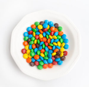 White bowl of colorful M&Ms