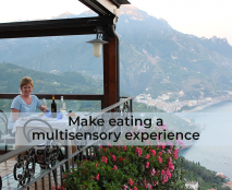 Michelle dining at a table overlooking the Amalfi Coast